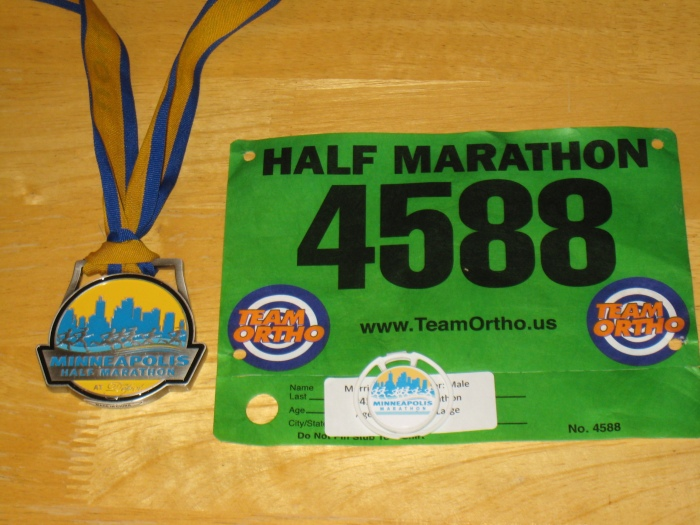 Race medal, race chip, and my bib #